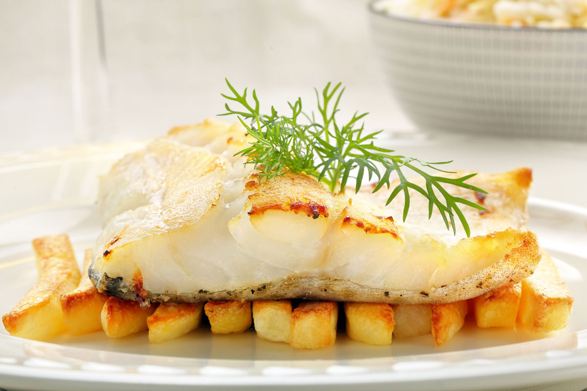 Sea bream baked in foil with potatoes