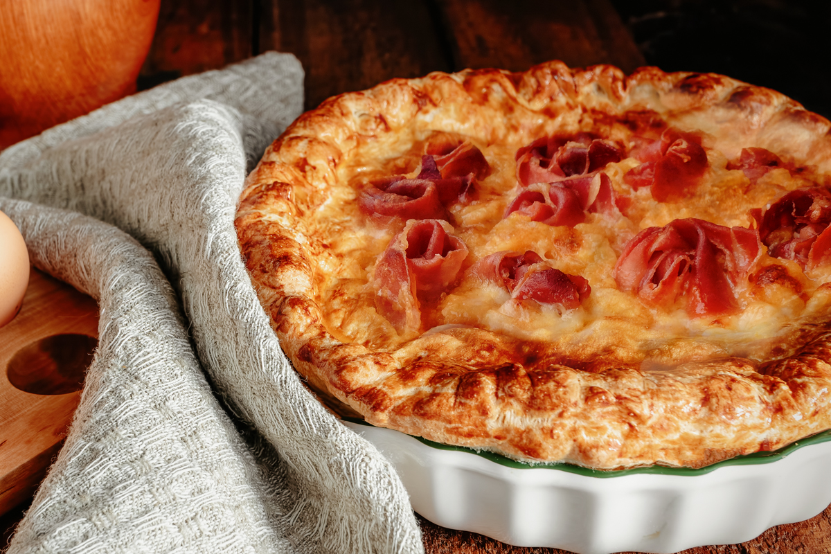 Savory pie with potatoes and speck