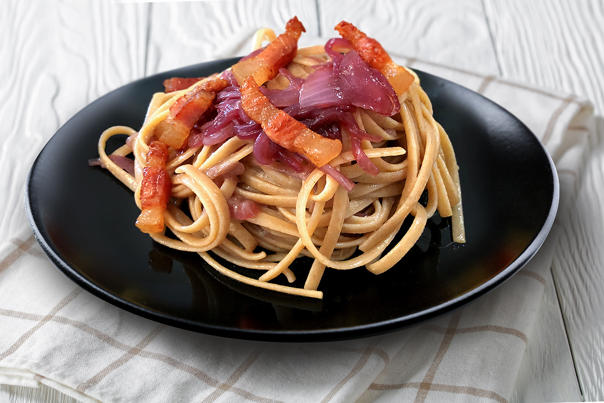 Stroncatura pasta with Tropea red onion and guanciale